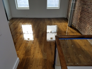 Manhattan Project: These floors are 5'' white oak planks with a custom stain finish.